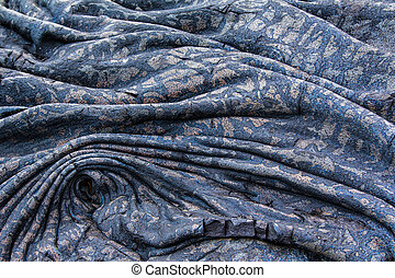Cooled colourful lava flow, Kilauea, Hawaii, forms patterned folds and look like folds in fabric.