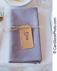 Folded Napkins With Name Tags at Reception