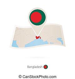 Folded paper map of Bangladesh with flag pin of Bangladesh.