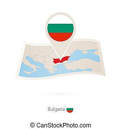 Folded paper map of Bulgaria with flag pin of Bulgaria.