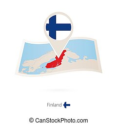 Folded paper map of Finland with flag pin of Finland.