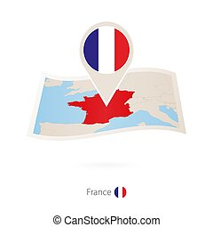 Folded paper map of France with flag pin of France.