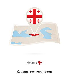 Folded paper map of Georgia with flag pin of Georgia.