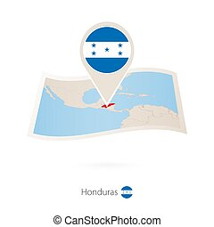 Folded paper map of Honduras with flag pin of Honduras....