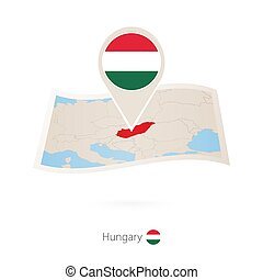 Folded paper map of Hungary with flag pin of Hungary.