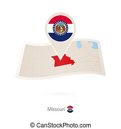 Folded paper map of Missouri U.S. State with flag pin of...