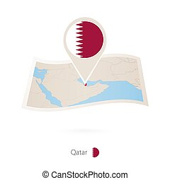 Folded paper map of Qatar with flag pin of Qatar.