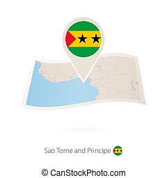 Folded paper map of Sao Tome and Principe with flag pin of Sao Tome and Principe.