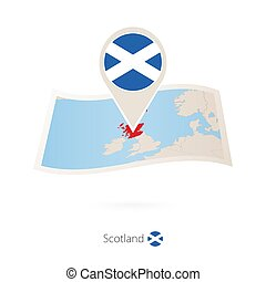 Folded paper map of Scotland with flag pin of Scotland....