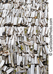 folded rows of firewood, close-up