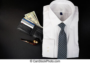 folded shirt with wallet and pipe