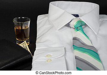 folded shirt with whiskey shot