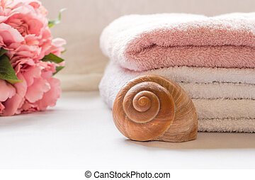 Folded towels on bathroom counter with flowers