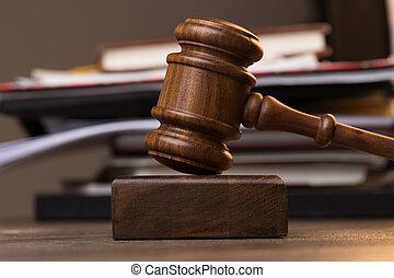 Folder, judge's hammer on table