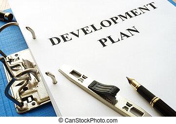 Folder with development plan in an office.