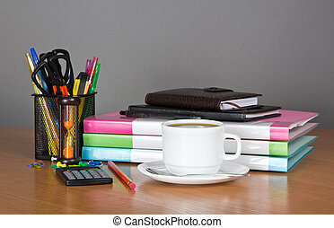 Folders, organizer, notepad, office accessories and cup of coffe