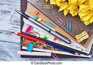 Folders with documents and stationery.