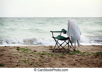 folding chair on shore