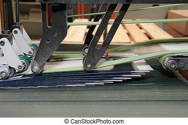 folding machine detail - detail of a folding machine with ...