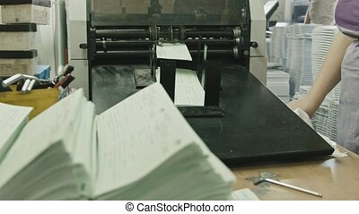 Folding machine folds printed offset sheet, polygraph industry