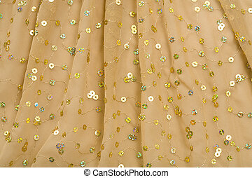 Folds of Brown Fabric with Spangles