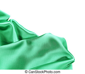 Folds of emerald satin. On a white background.