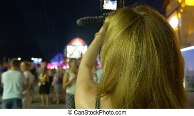 folk festivities, a holiday, people look at the stage and on...