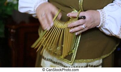 Folk instrument on home - Ukrainian folk instrument Ratchet.