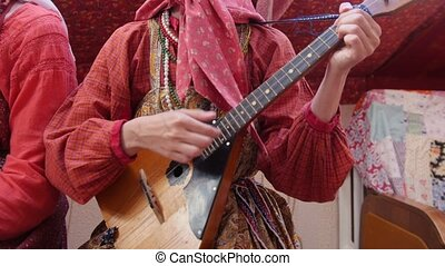 Folk music russian ensemble - woman in Russian folk costume...