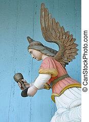 Folk sculpture of wooden angel