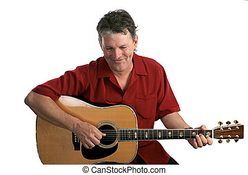 A handsome folk singer-guitarist laughing as he performs a song.