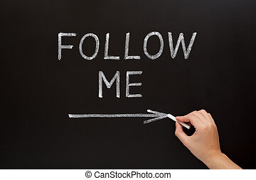 Follow Me Blackboard Concept - Hand writing Follow Me with...