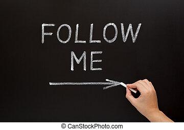 Follow Me Blackboard Concept - Hand writing Follow Me with...