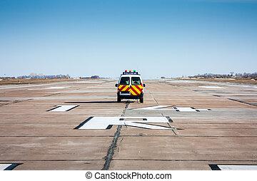 Follow me car at the airport runway