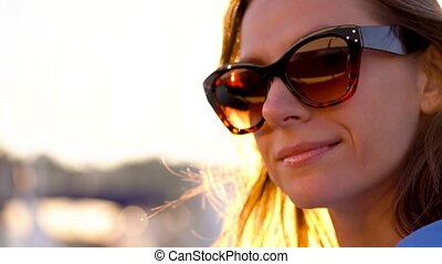 Follow me - happy young woman in sunglasses pulling guy's...