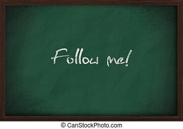 Follow me text handwritten on a chalkboard