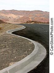 Follow the Curb. - concrete curb and asphalt