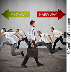 Follow the hard way for success. - Group of people run ...