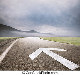 Follow the right way - Road with arrow drawn on asphalt....