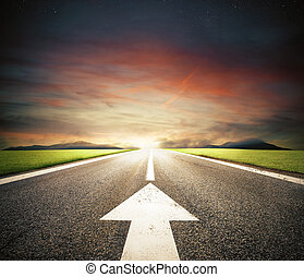Follow the road to success - Road with an white arrow on...