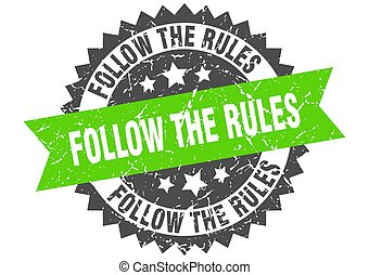 follow the rules stamp. grunge round sign with ribbon