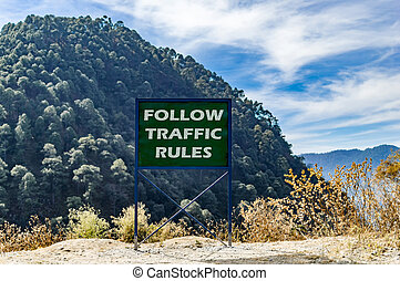 Follow traffic rules text message on the board.