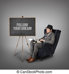 Follow your dream text on  blackboard with businessman