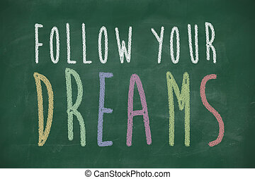 follow your dreams phrase handwritten on blackboard