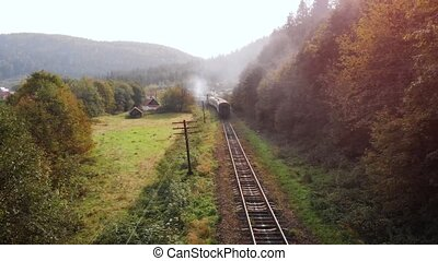 Following a passenger train through the rural village of Yaremche, in the Carpathian Mountains of Ukraine