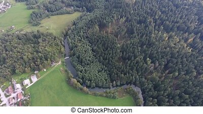Following a river flow. Aerial footage of Rinza near...