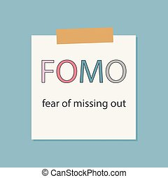 FOMO fear of missing out written in a notebook paper