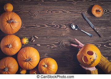fond, bois, sur, halloween, tenant mains, citrouille