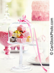 Fondant fancies on a dessert table