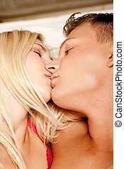 Fondness - Close-up of caucasian couple kissing in bed